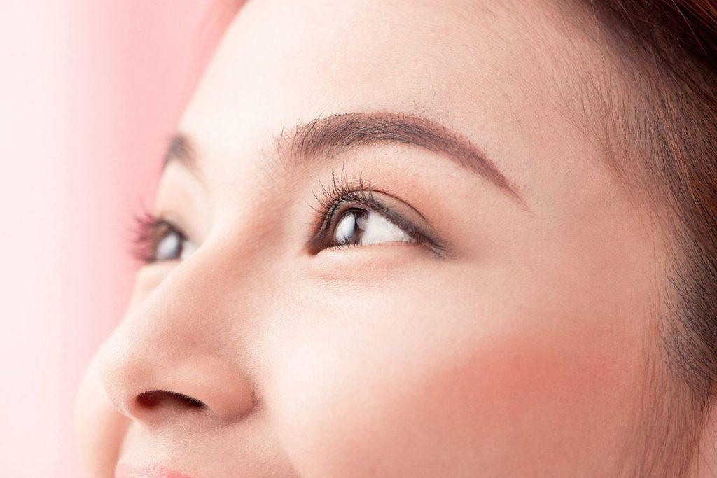 The face of a woman to showcase eyebrow embroidery for Demystifying the Microblading Trend blog banner